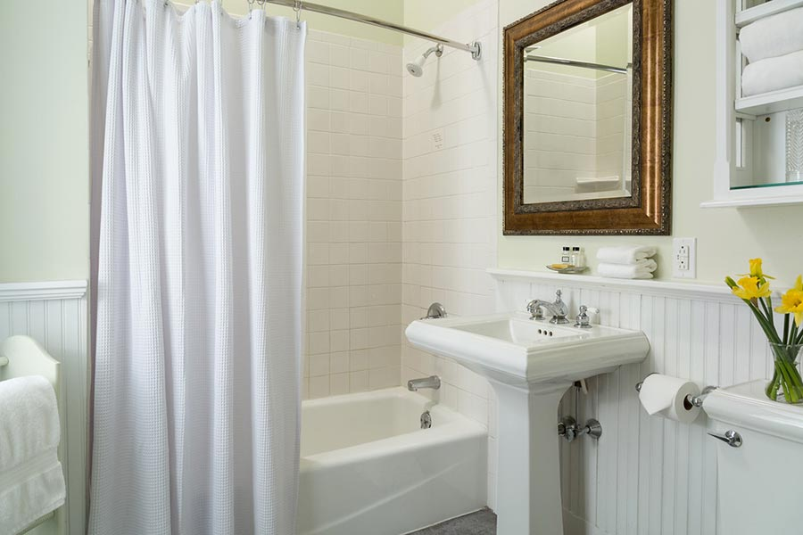Bathroom showing sink and tub of hotel