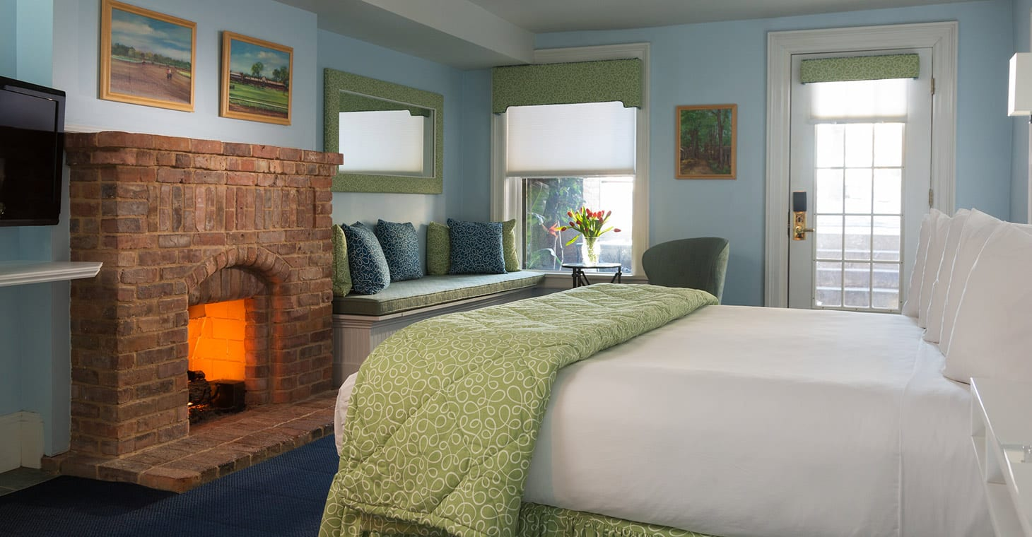 Garden Level King room bed and fireplace