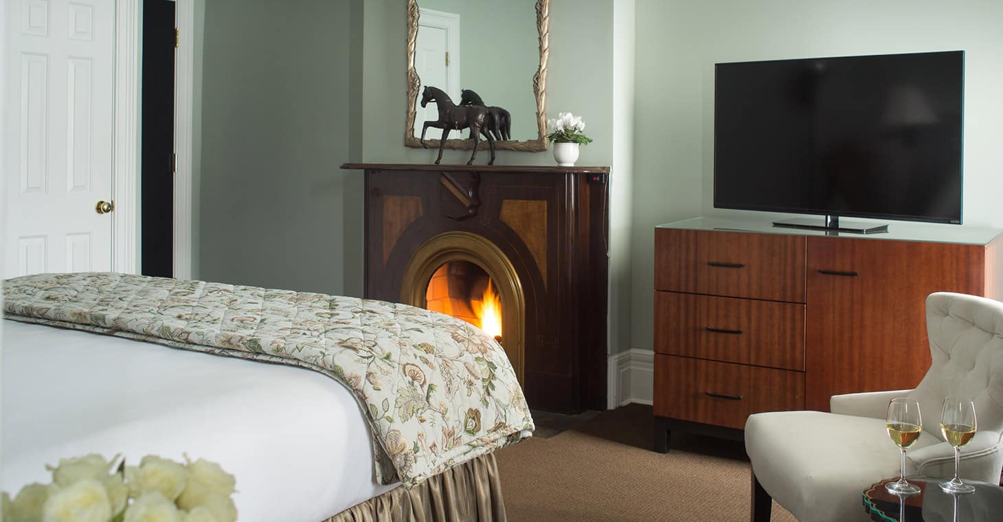 King room with fireplace at Saratoga Arms Luxury Hotel