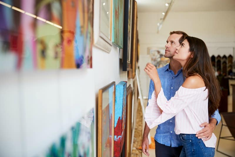 Couple looking at art paintings