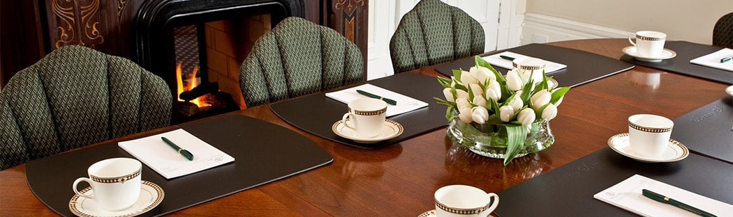 Meeting at Board Room Table at a Saratoga Springs hotel