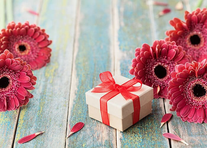 Gift box surrounded by flowers